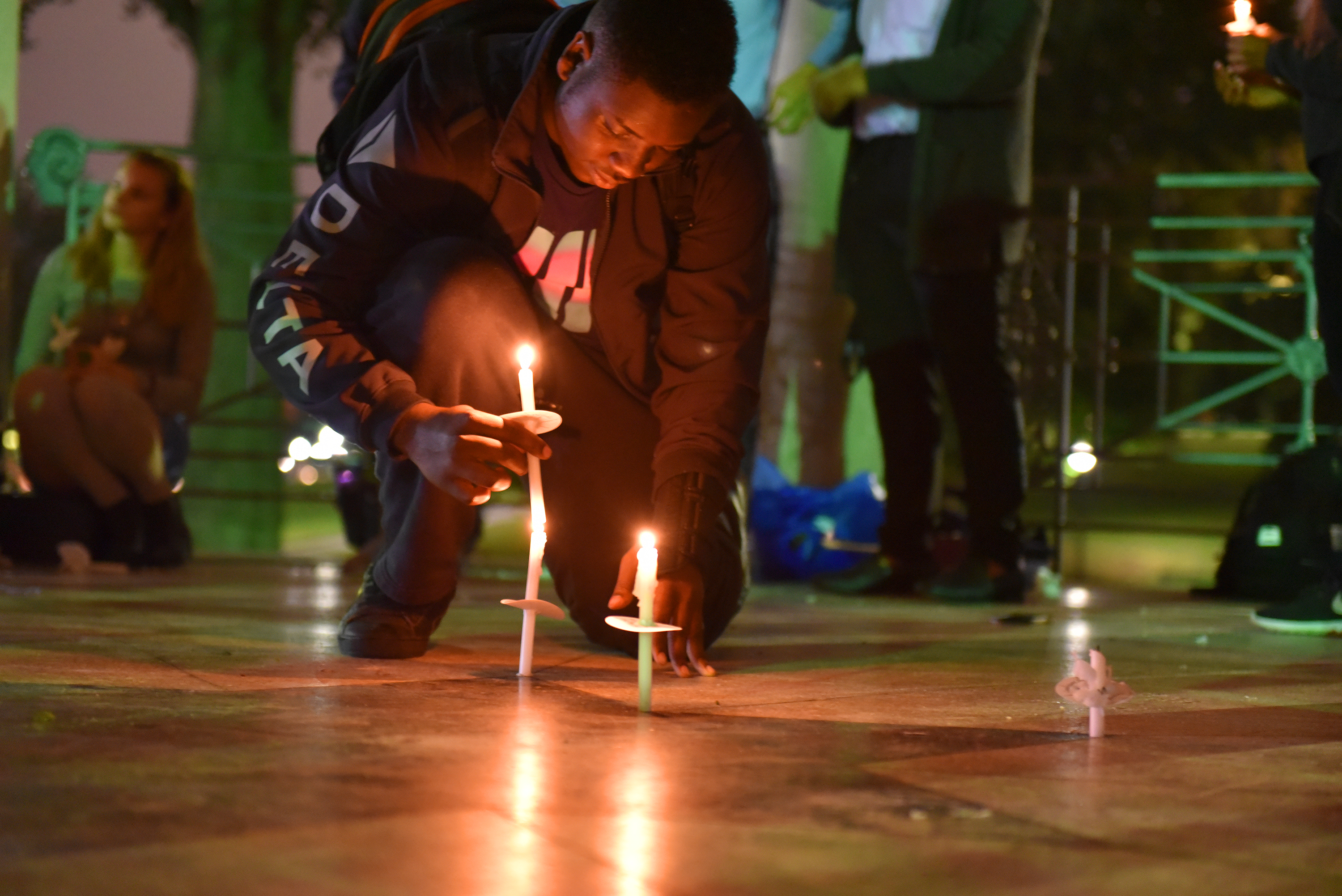 Student lights candle