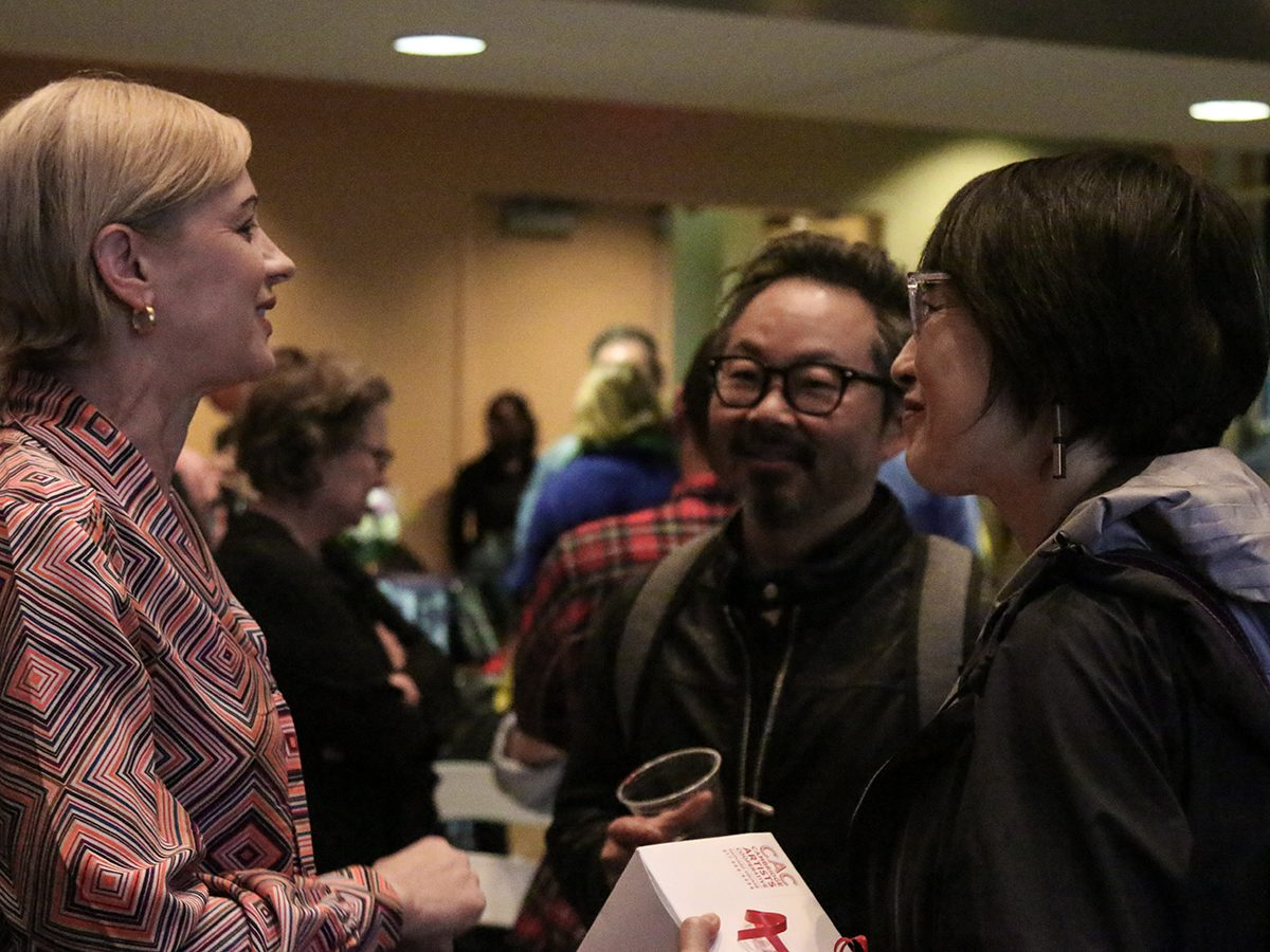 Faculty mingle at reception