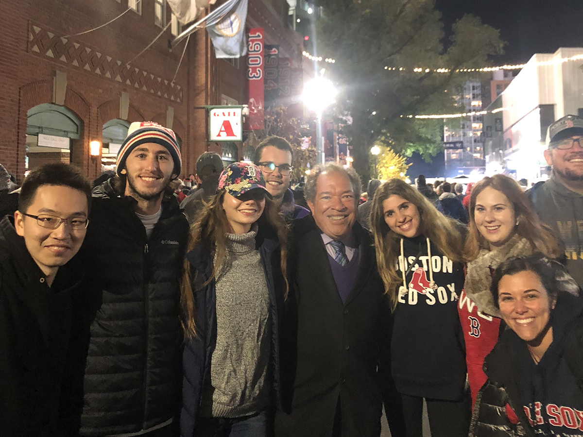 Dr. Charles Steinberg with students outside Fenway Park