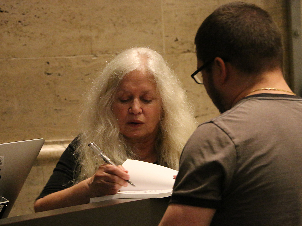 Amy Hempel signs a book for a fan
