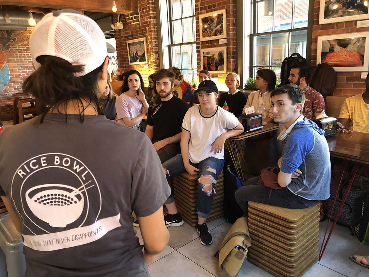Students listen to Alison Fong at Bon Me