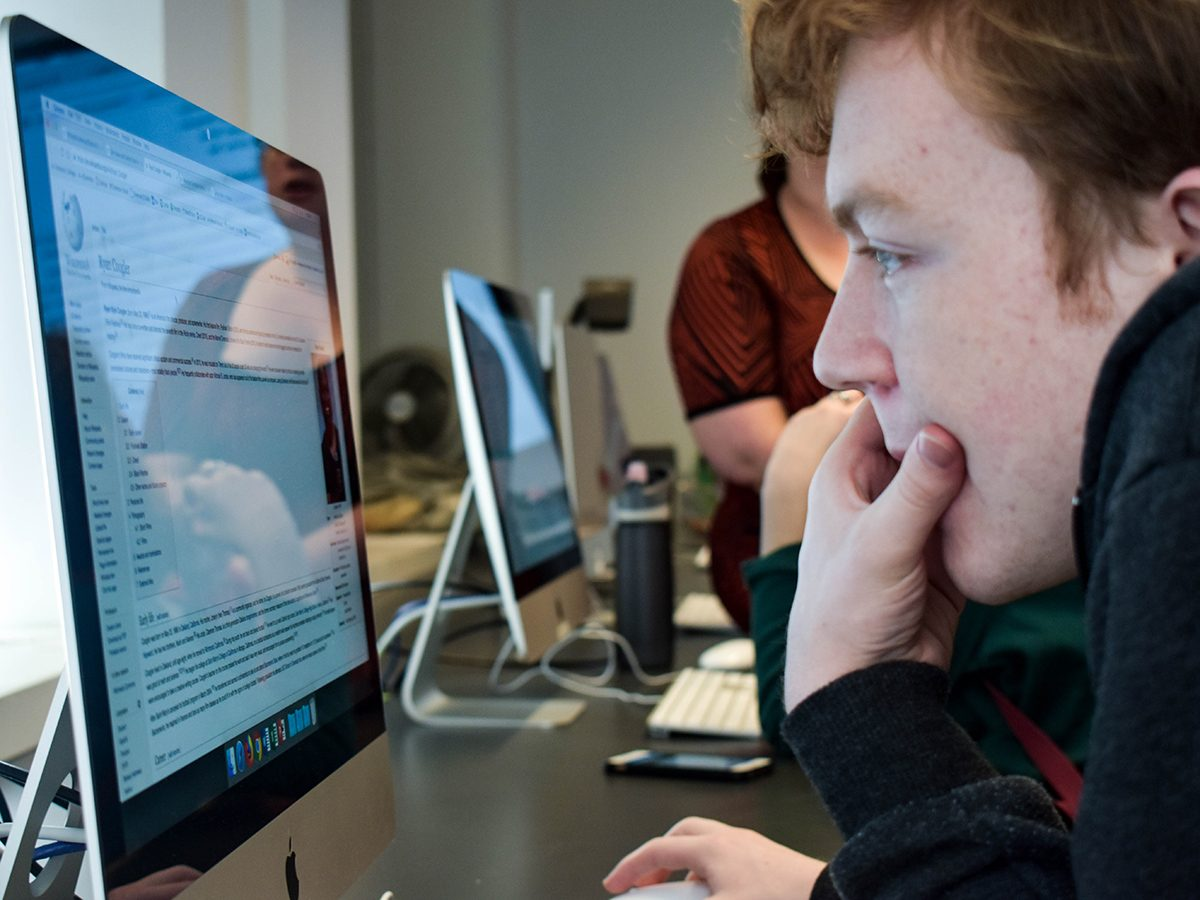 Student stares at Wiki page on screen
