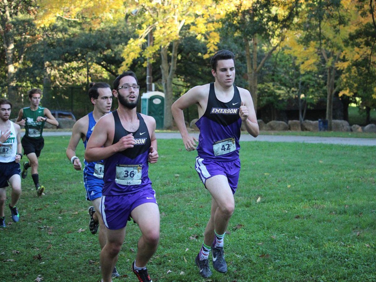 Men's cross country runners on trail