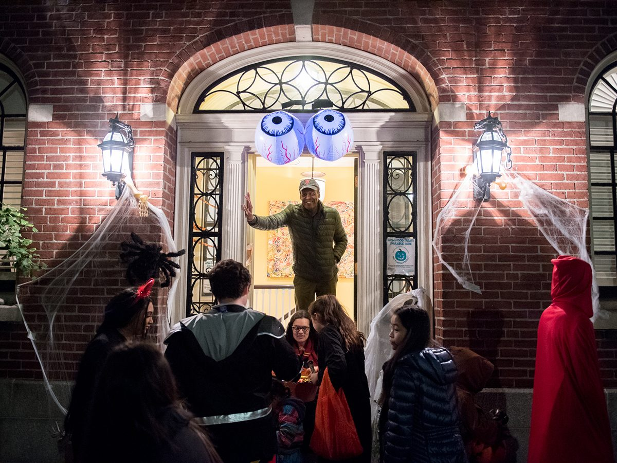 President Pelton in lit doorway