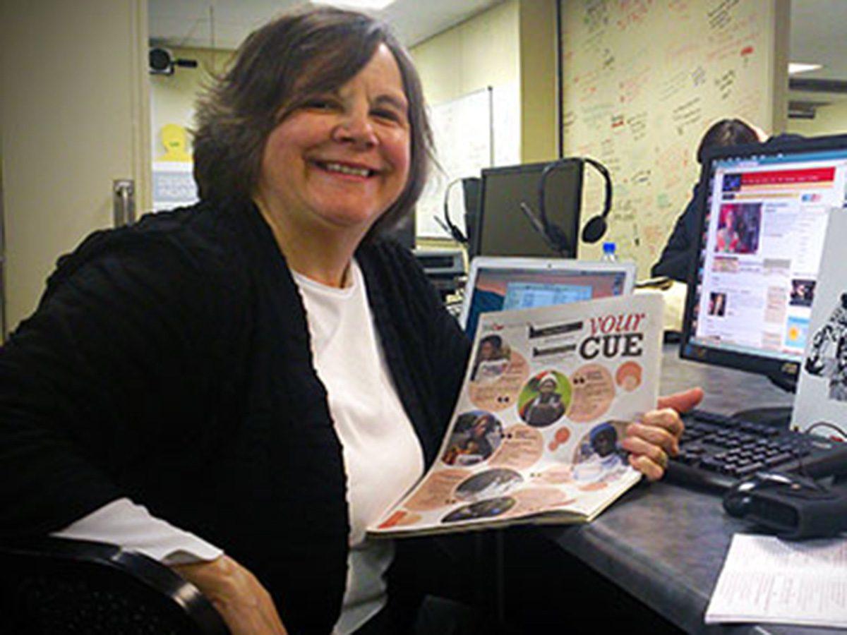 Janet Kolodzy at desk