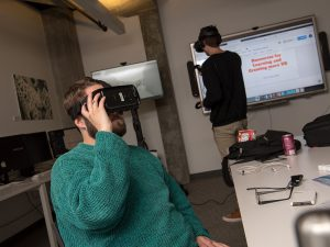Students look through VR goggles