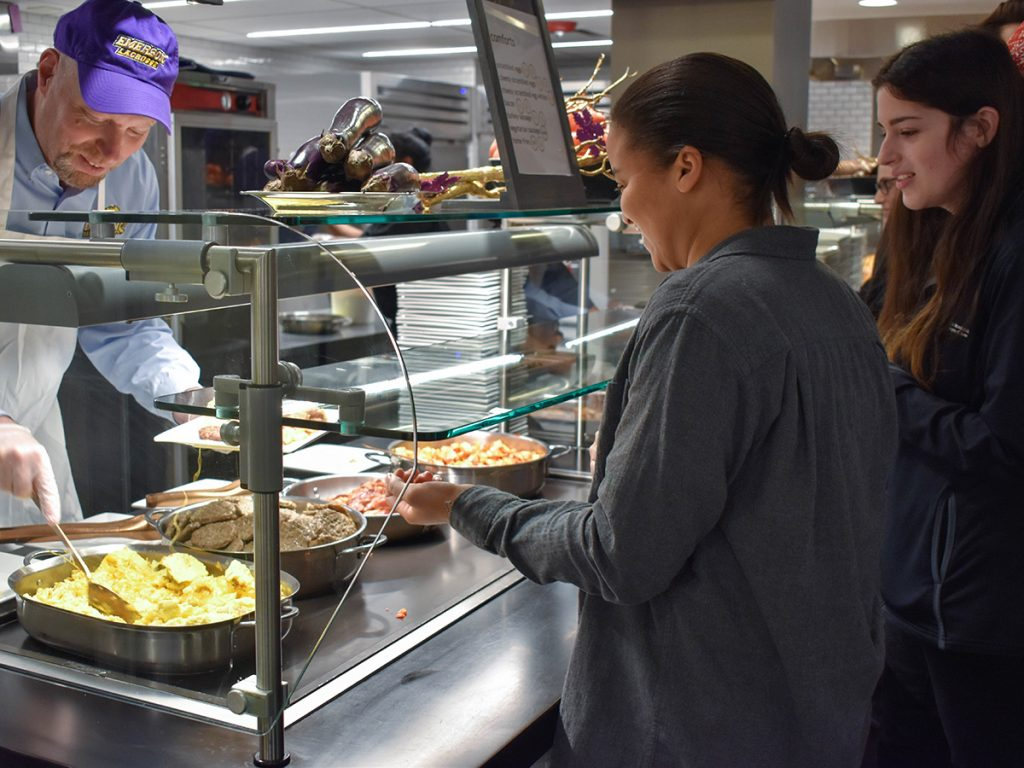 serving breakfast to students