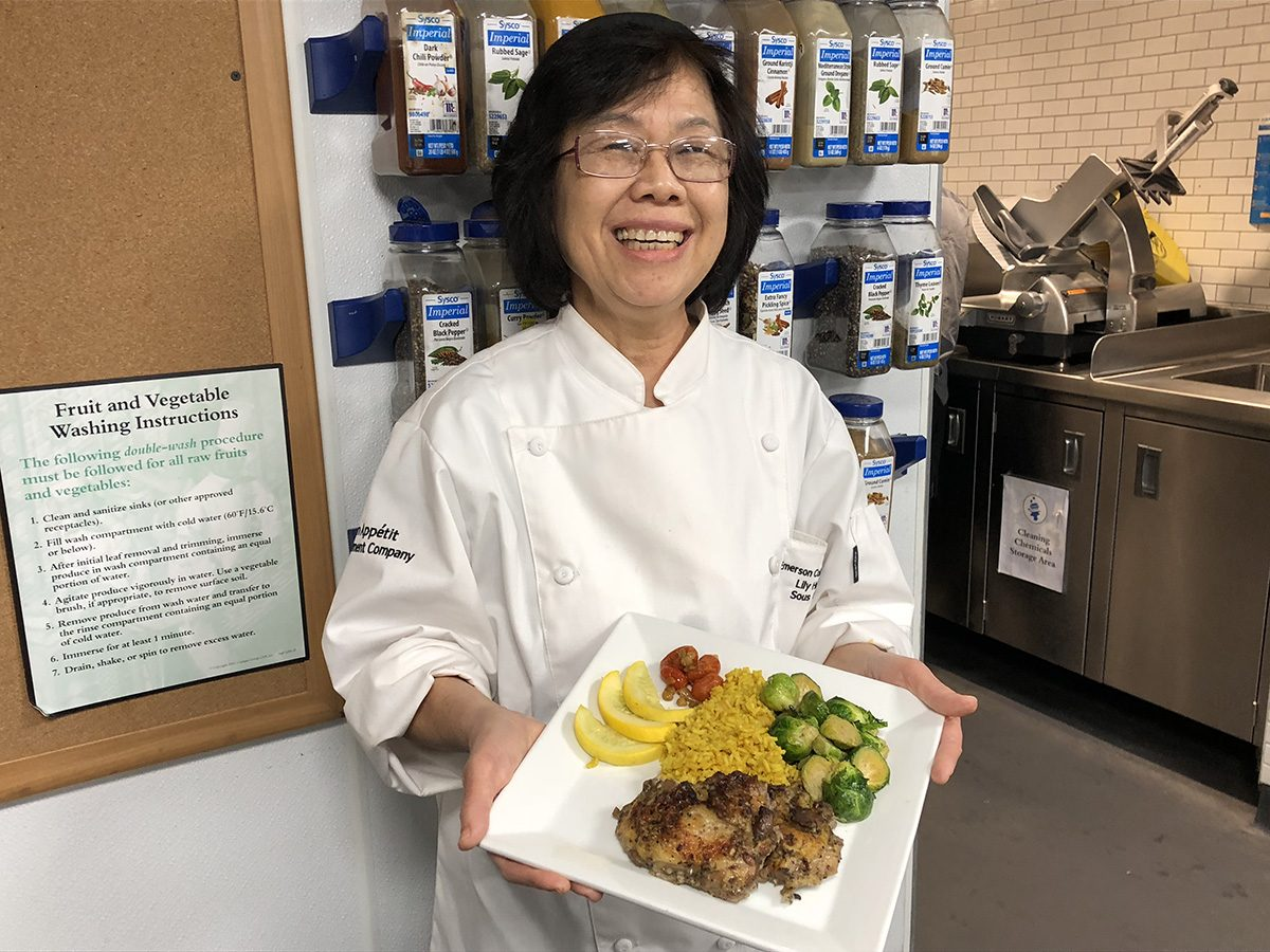 Sous chef Lih Lih Huang displays jerk chicken and sides.