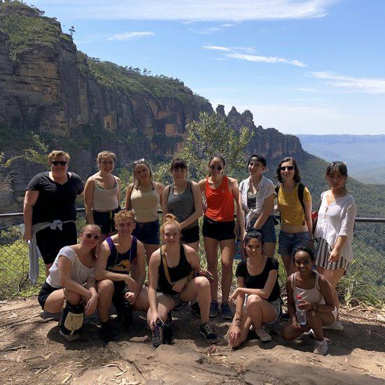 Students pose on Australian cliff