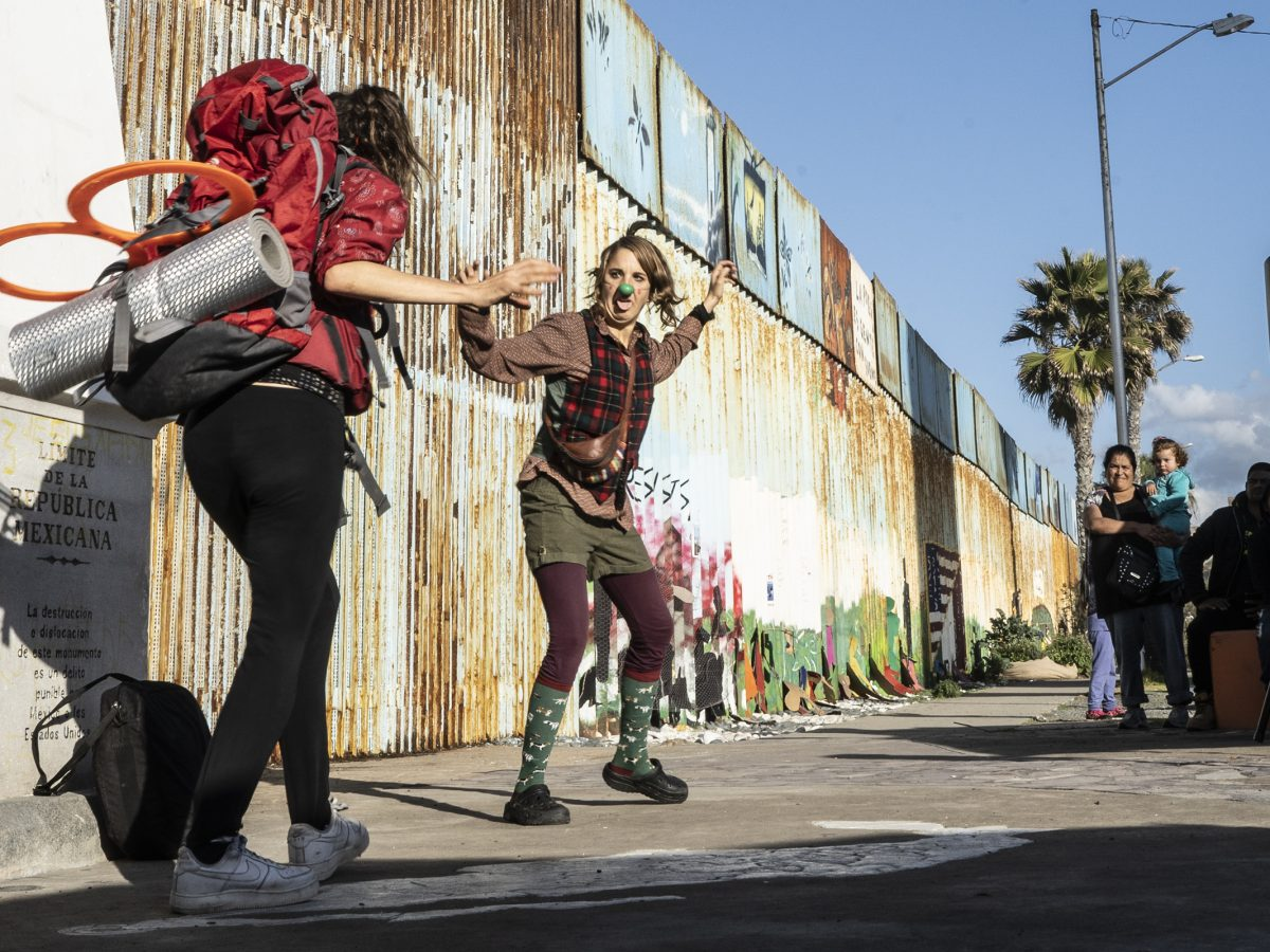 Two Spanish buskers performed as clowns at a Three Kings Day celebration by a border wall of Mexico and the U.S.