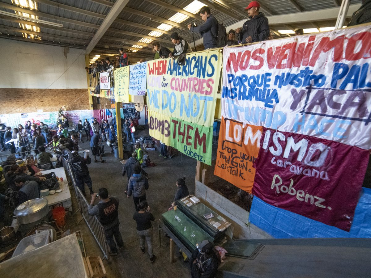 Protestors displayed signs inside a migrant shelter in Tijuana.