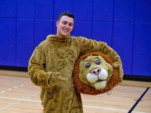 Junior Sam Knox has been Griff the Lion, Emerson College's mascot, since 2017.