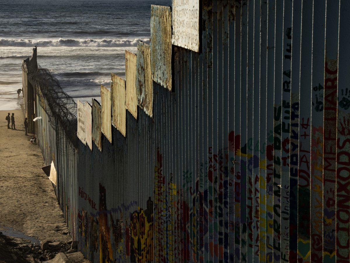 A border wall on the beach separates Mexico from the U.S., but can easily be diverted by walking a few feet into the water and walking around the wall.
