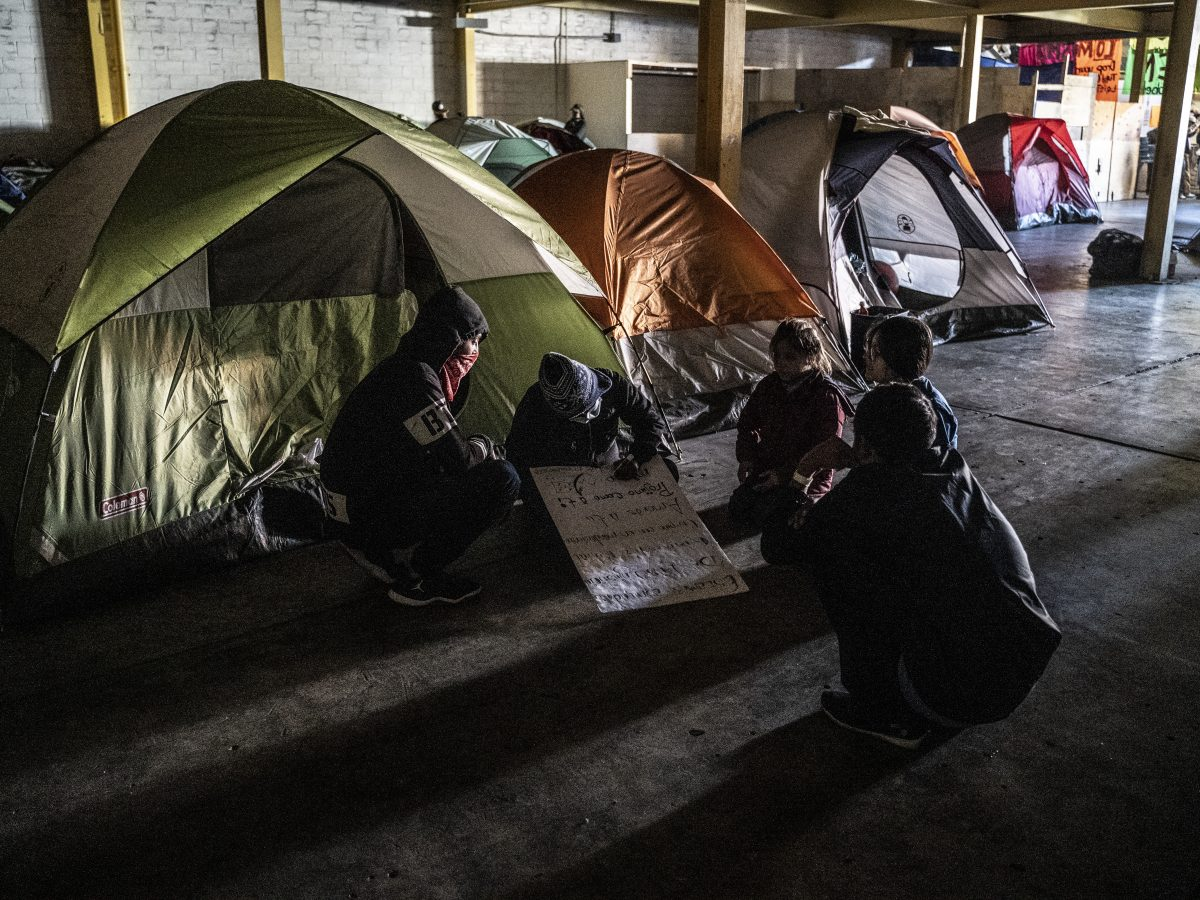 Immigrants have set up tents in a migrant shelter in Tijuana.