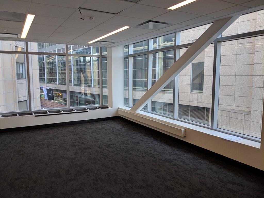 Corner room overlooking building