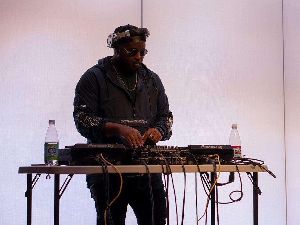 man wearing headphones behind sound board