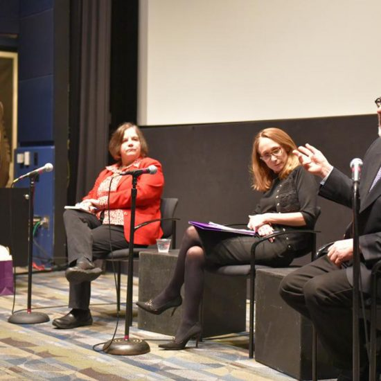 Four panelists in Bright Screening room