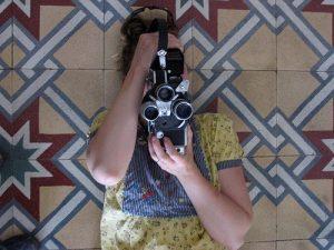 Ramey behind a camera