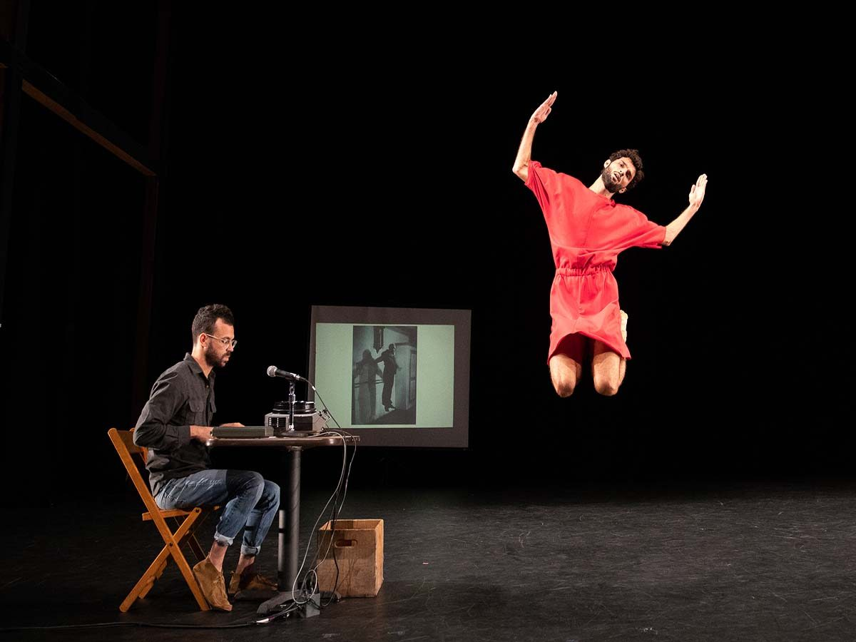 David Kishik on stage with dancer