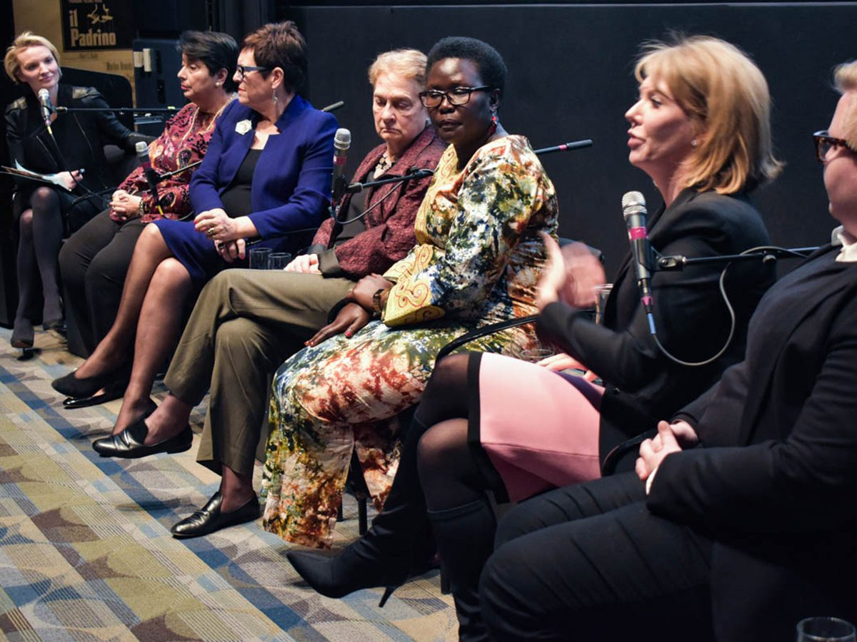 Seven women sit on panel