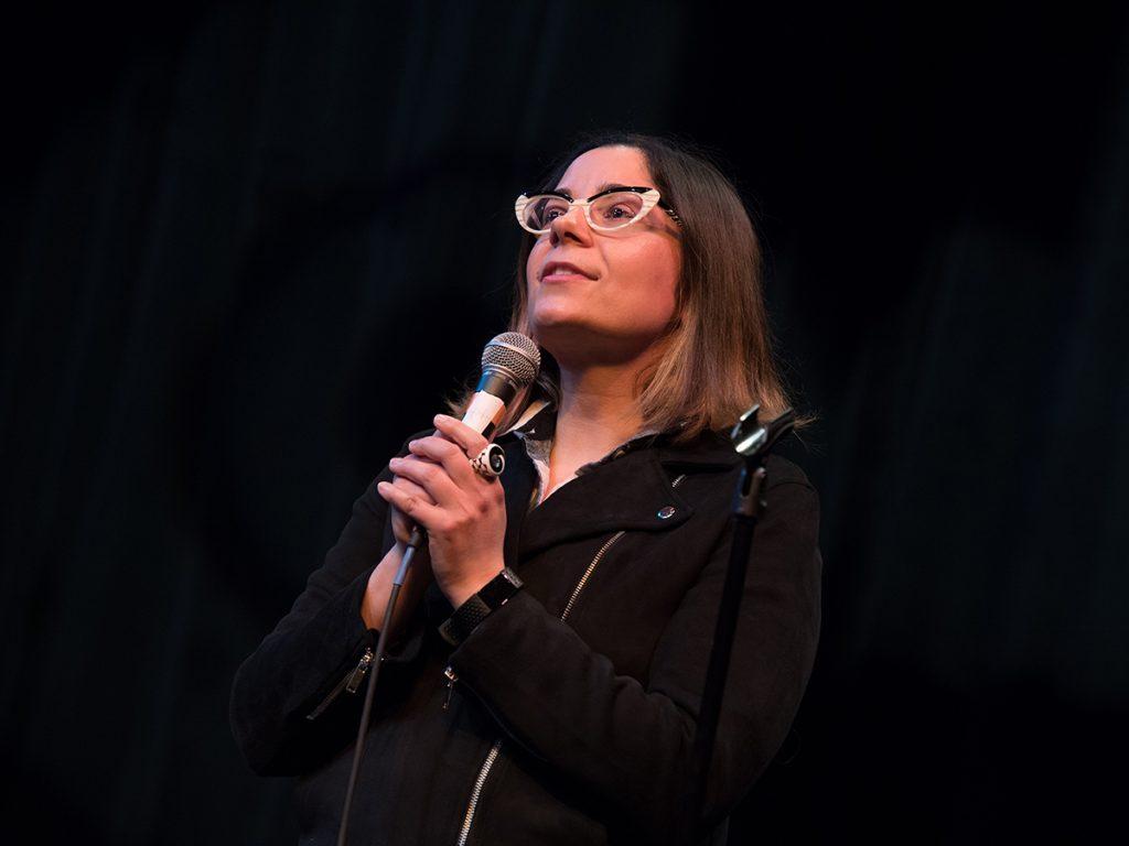 woman talks into mic
