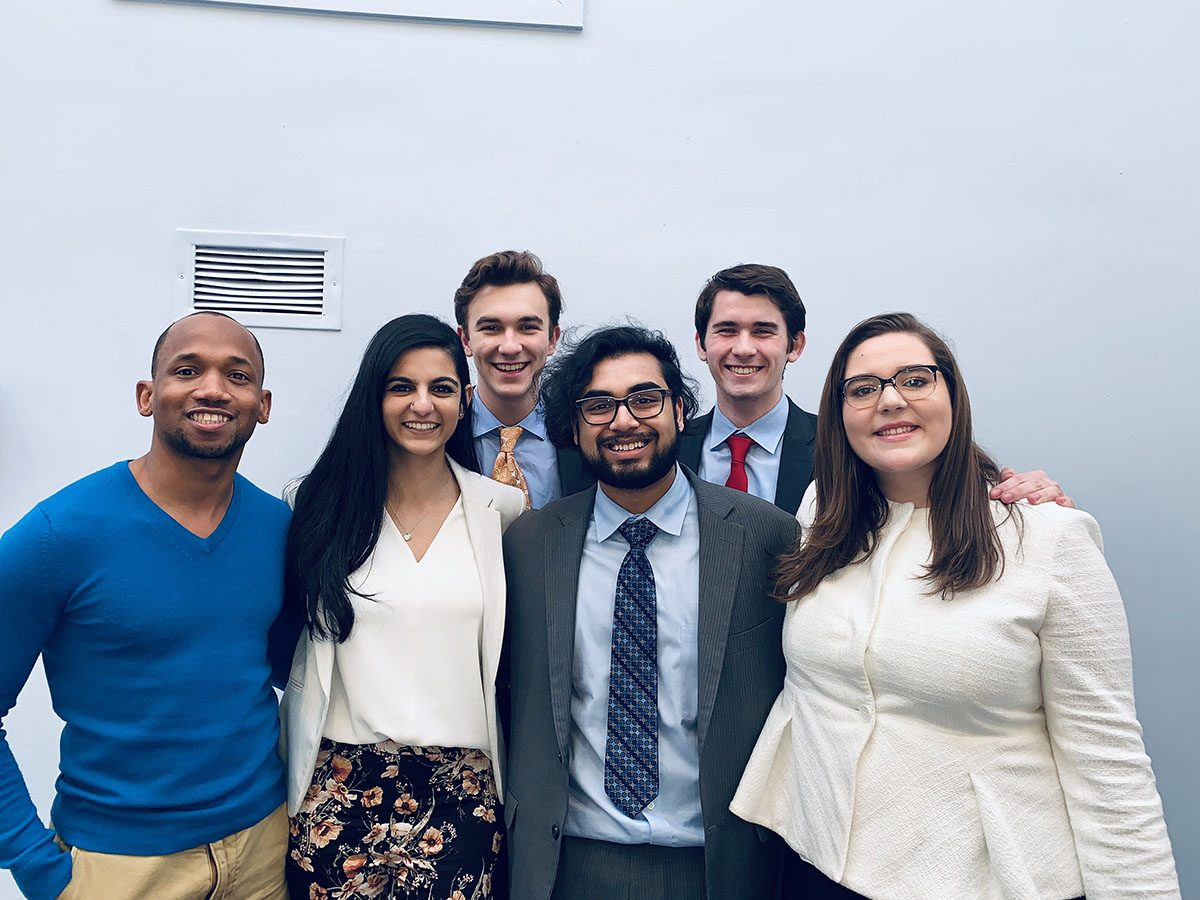 Emerson College's Forensics Team includes William Rowley, Jack Degnan, Director of Forensics Deion Hawkins, Jenna Dewji, Karthik Ramaswami and Sara Hathaway.