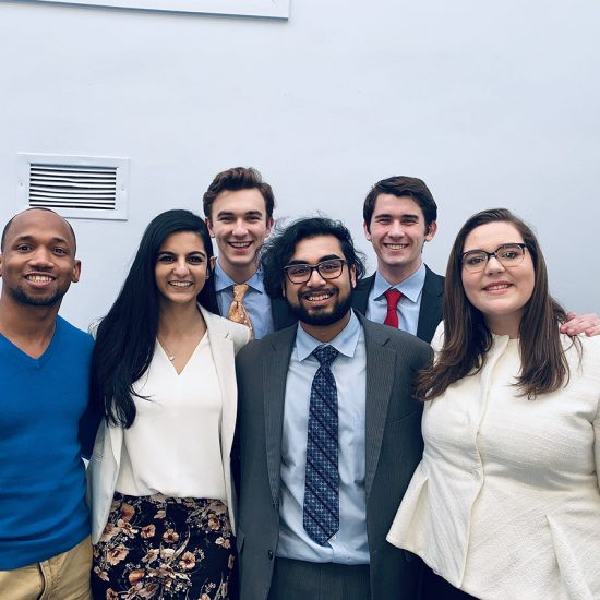 Emerson College's Forensics Team includes William Rowley, Jack Degnan, Director of Forensics Deion Hawkins, Jenna Dewji, Karthik Ramaswami and Sara Hathaway.