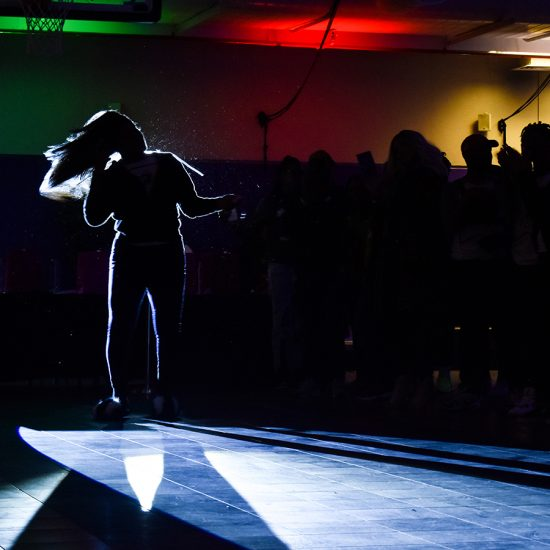backlit dancer on runway
