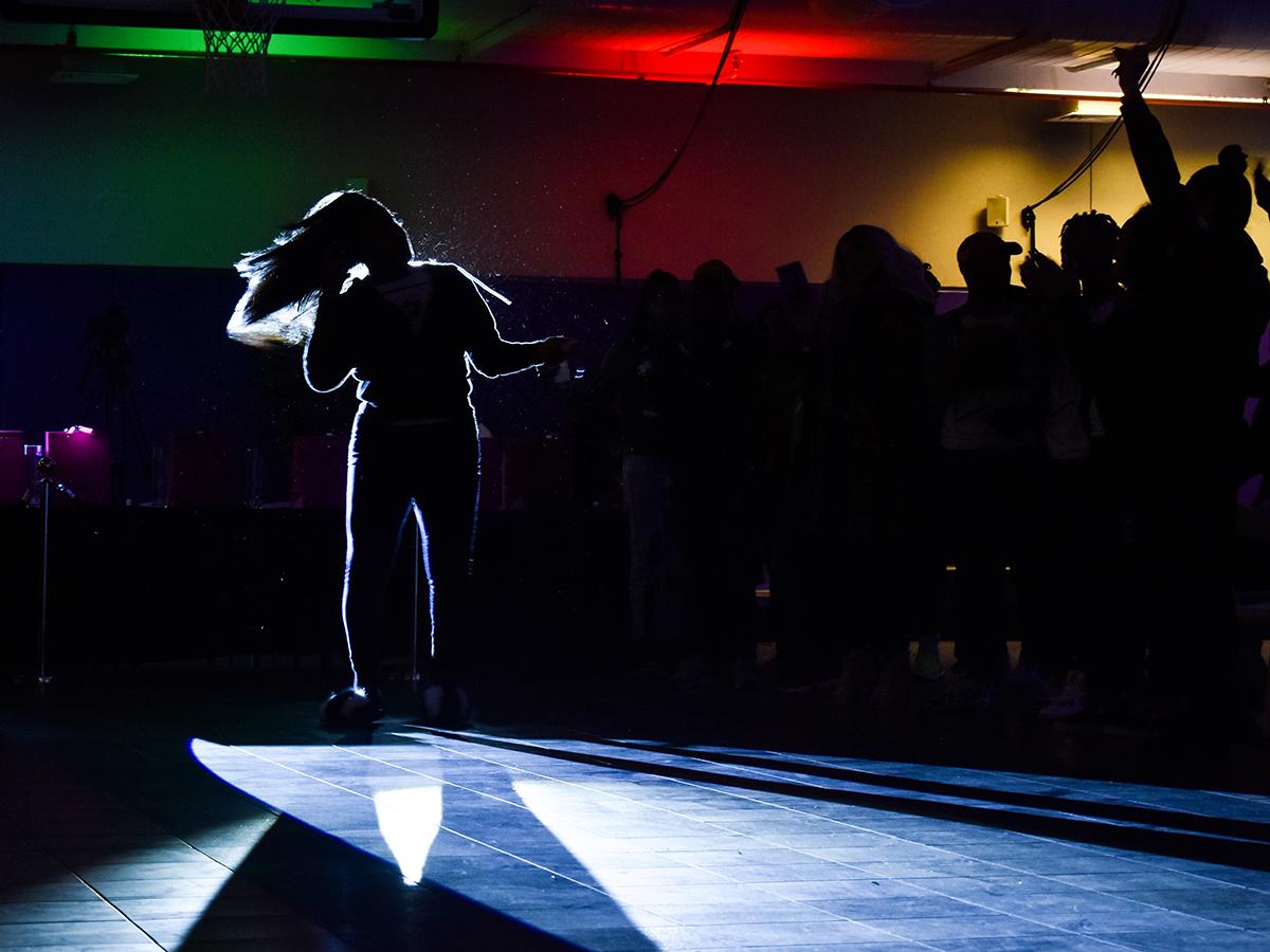 backlit dancer on runway