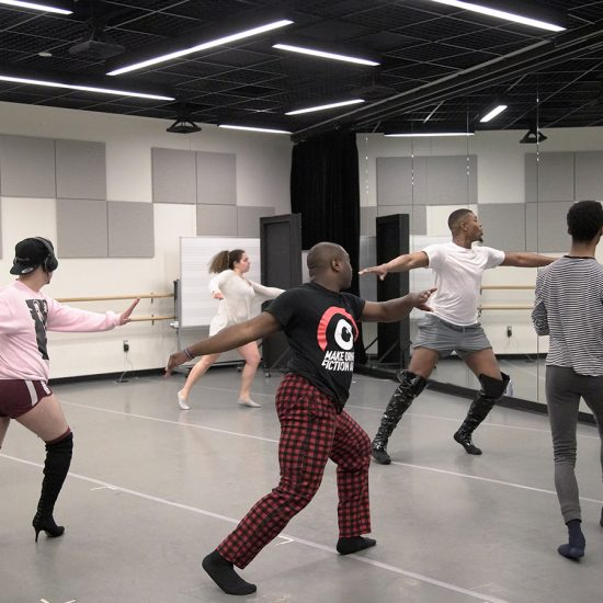 students practice vogue moves