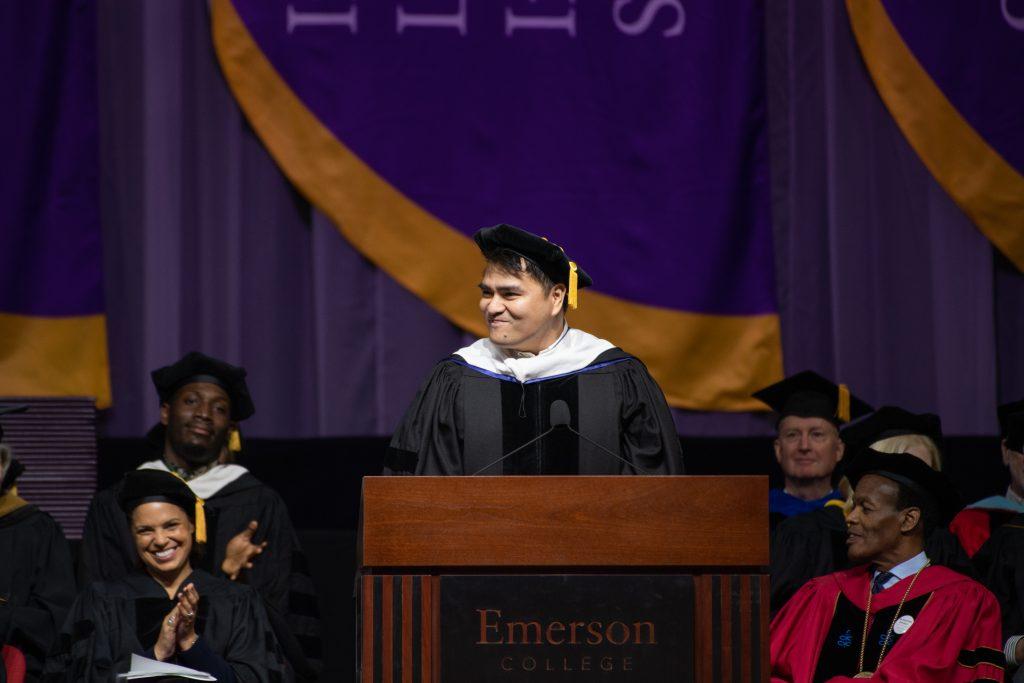 Vargas in regalia at podium