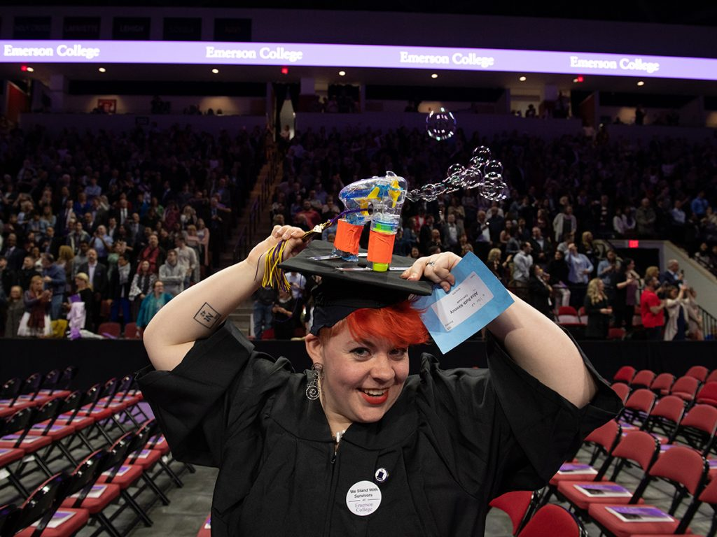 woman with bubble maker on mortarboard