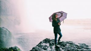 Vendi Pavic holds an umbrella
