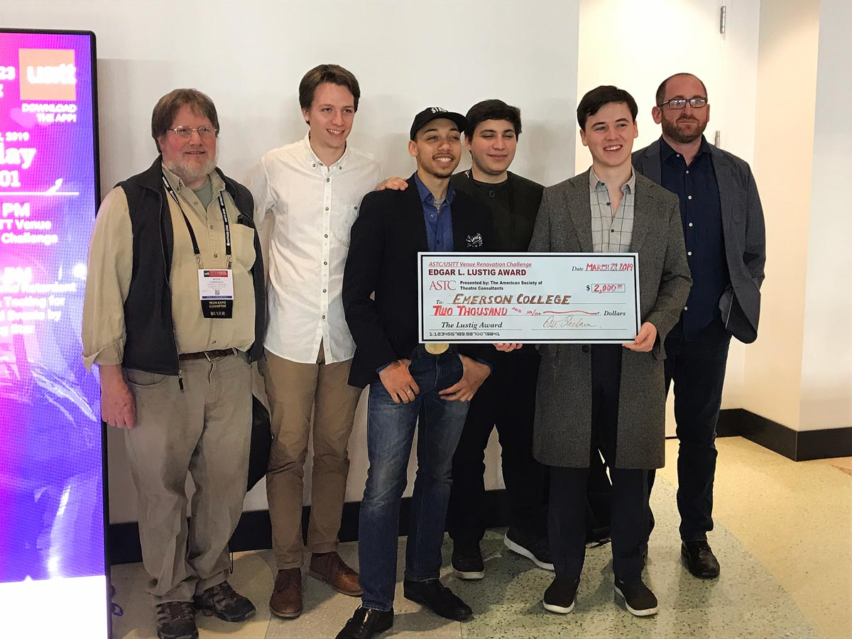 students, faculty with big check