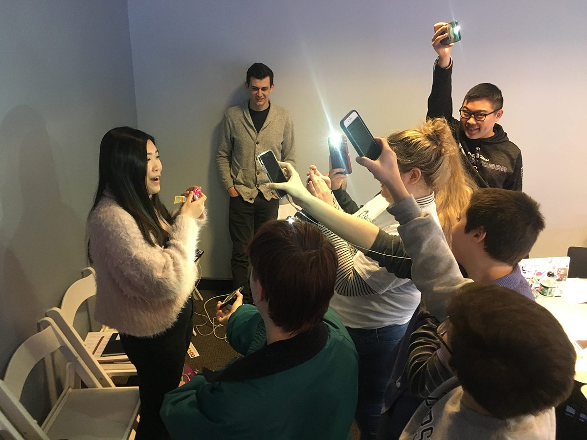 students take video of woman with phones
