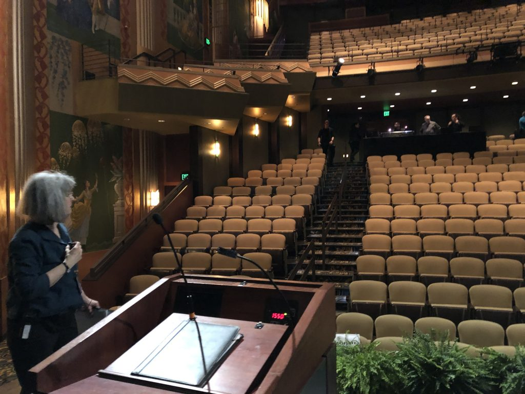 Vicky Peterson coordinated the final details from the Paramount's stage before everyone filled the theater.