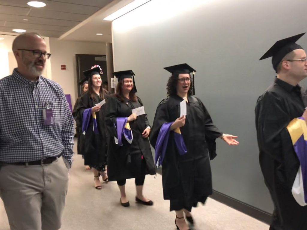 Graduating students walked to the theater singing Pomp and Circumstance.
