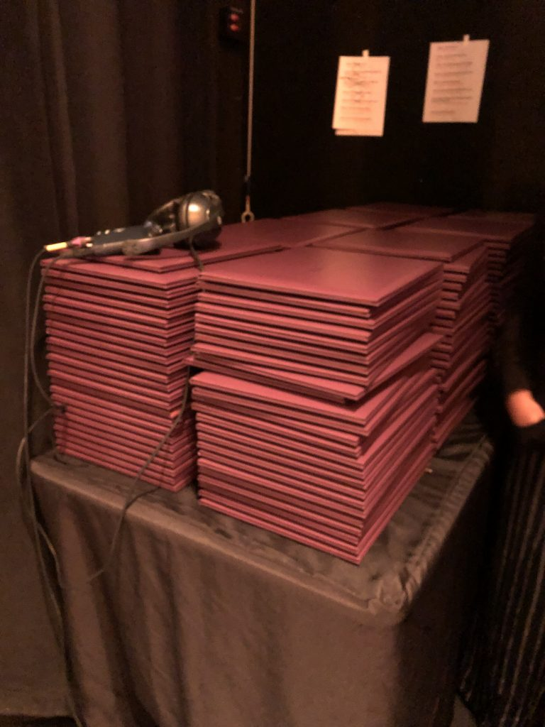 Diplomas rested atop each other before going to their very earned graduates.