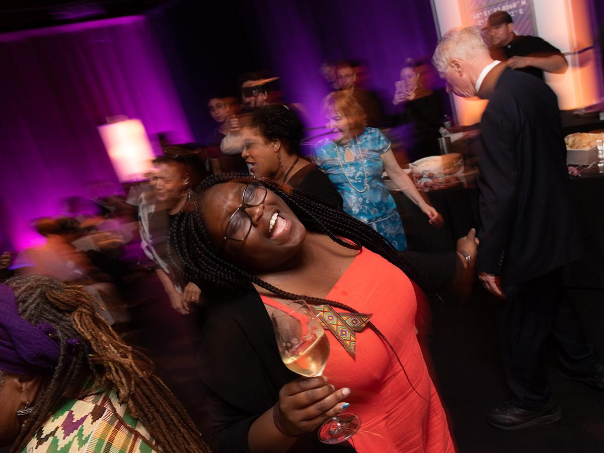 woman dances with wine glass