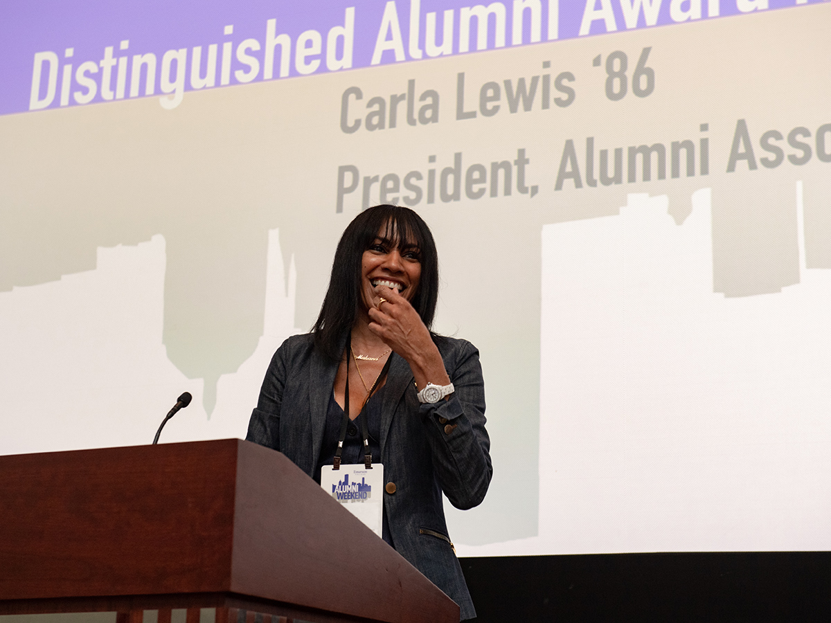 Alumni Association president Carla Lewis at podium