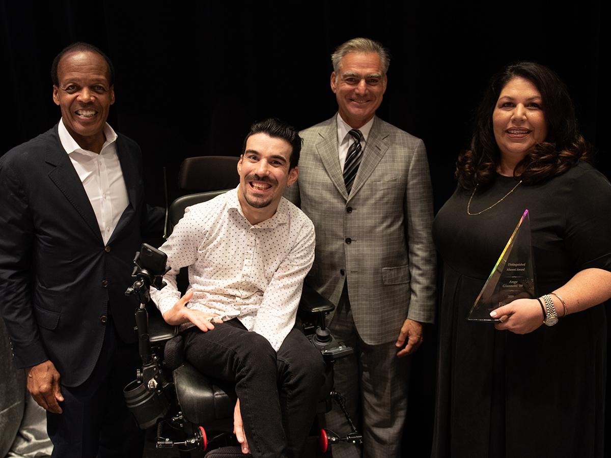 Three alumni achievement recipients with President Pelton