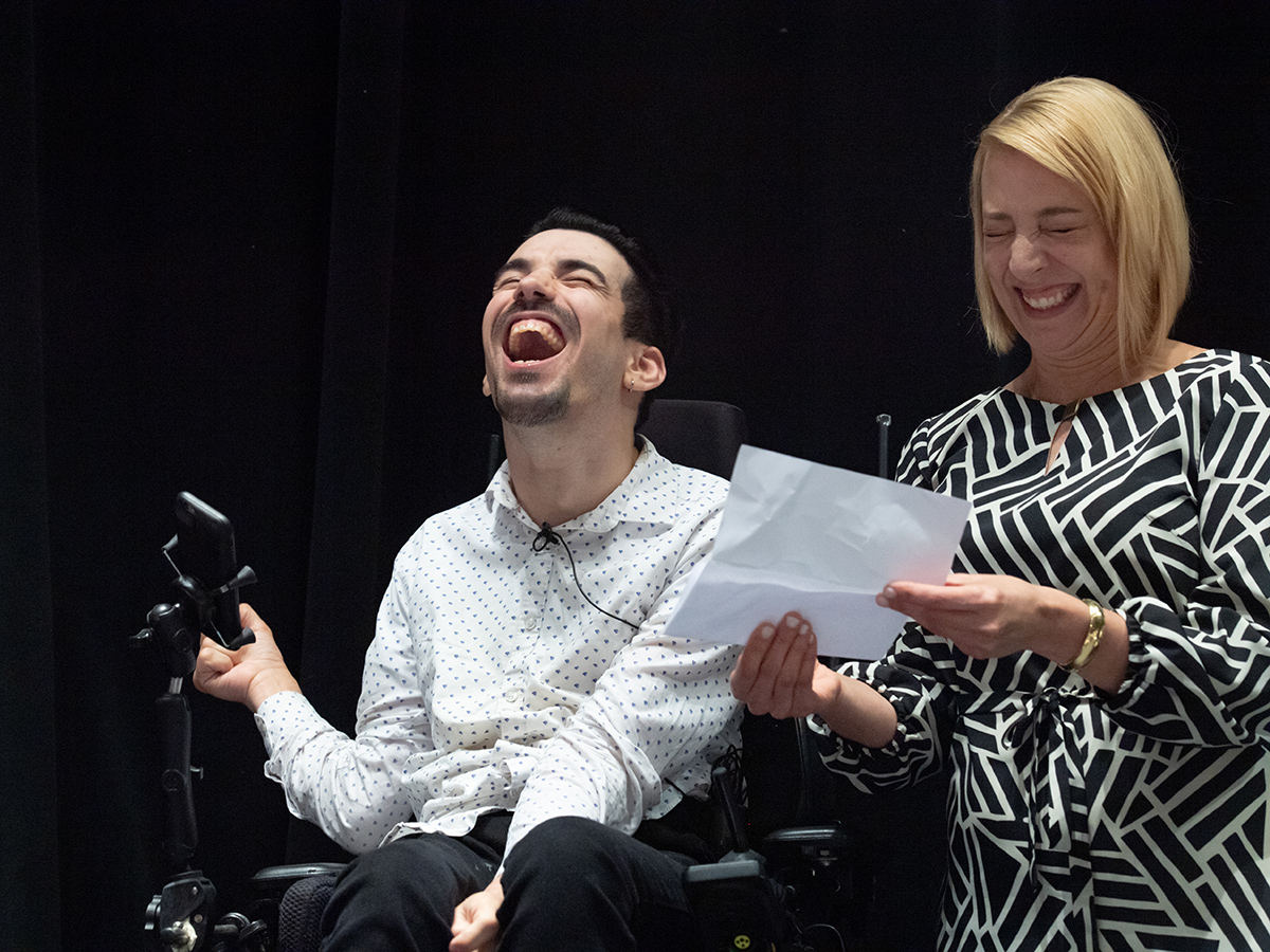 Alexander Freeman '14 and AVP of Alumni Engagement Leigh Gaspar laugh