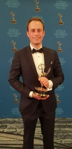 Dustin Wlodkowski with his Emmy