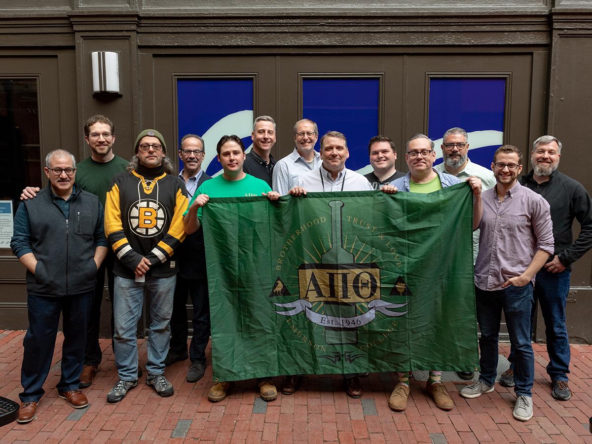 fraternity holds banner