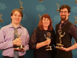 Carol Sisco with two colleagues and their Emmys