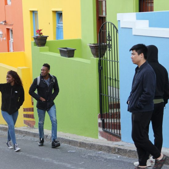 walking up street with colorful houses