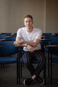 Dustin Lance Black sitting in a chair