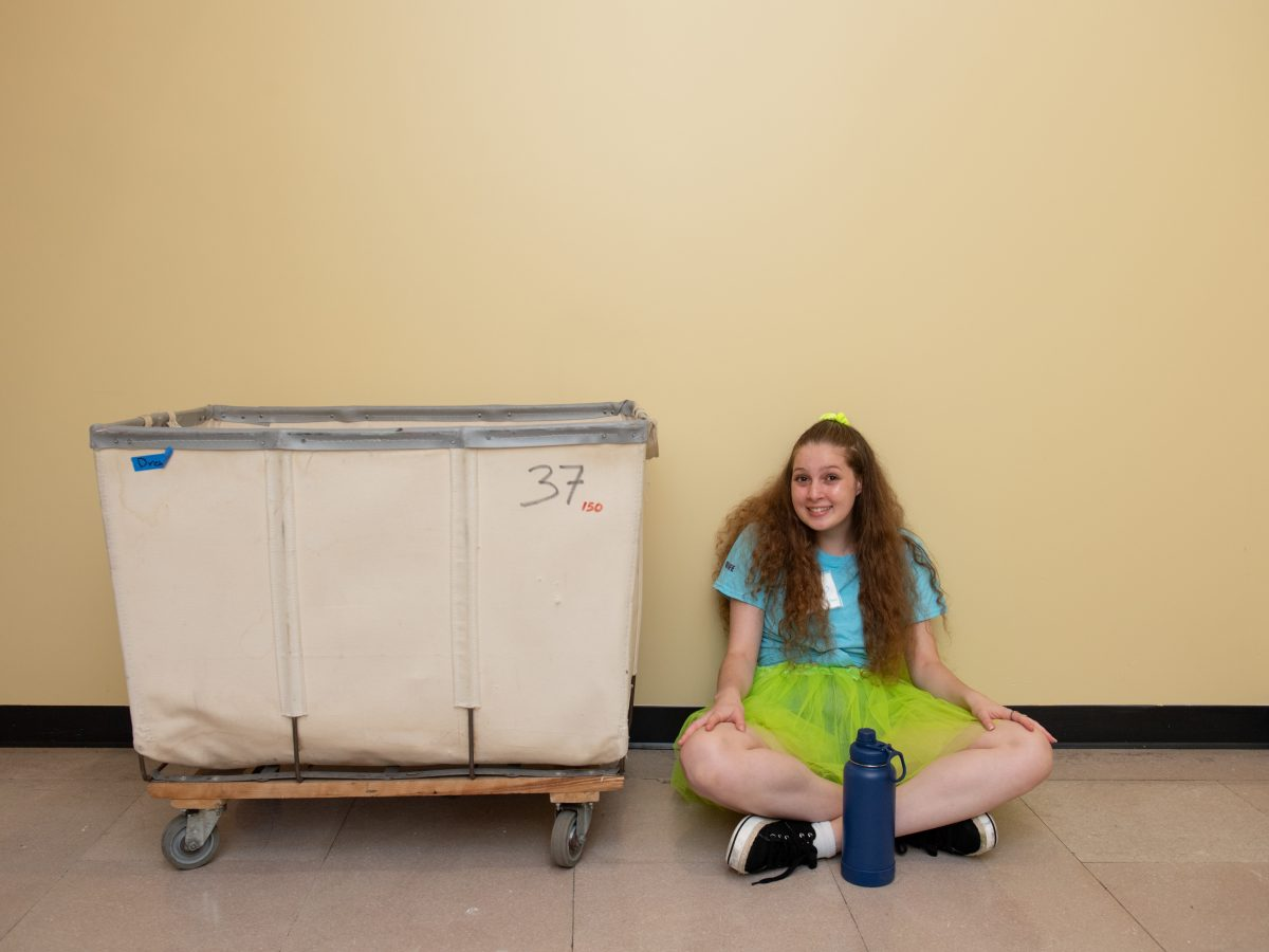 A student sits on the ground