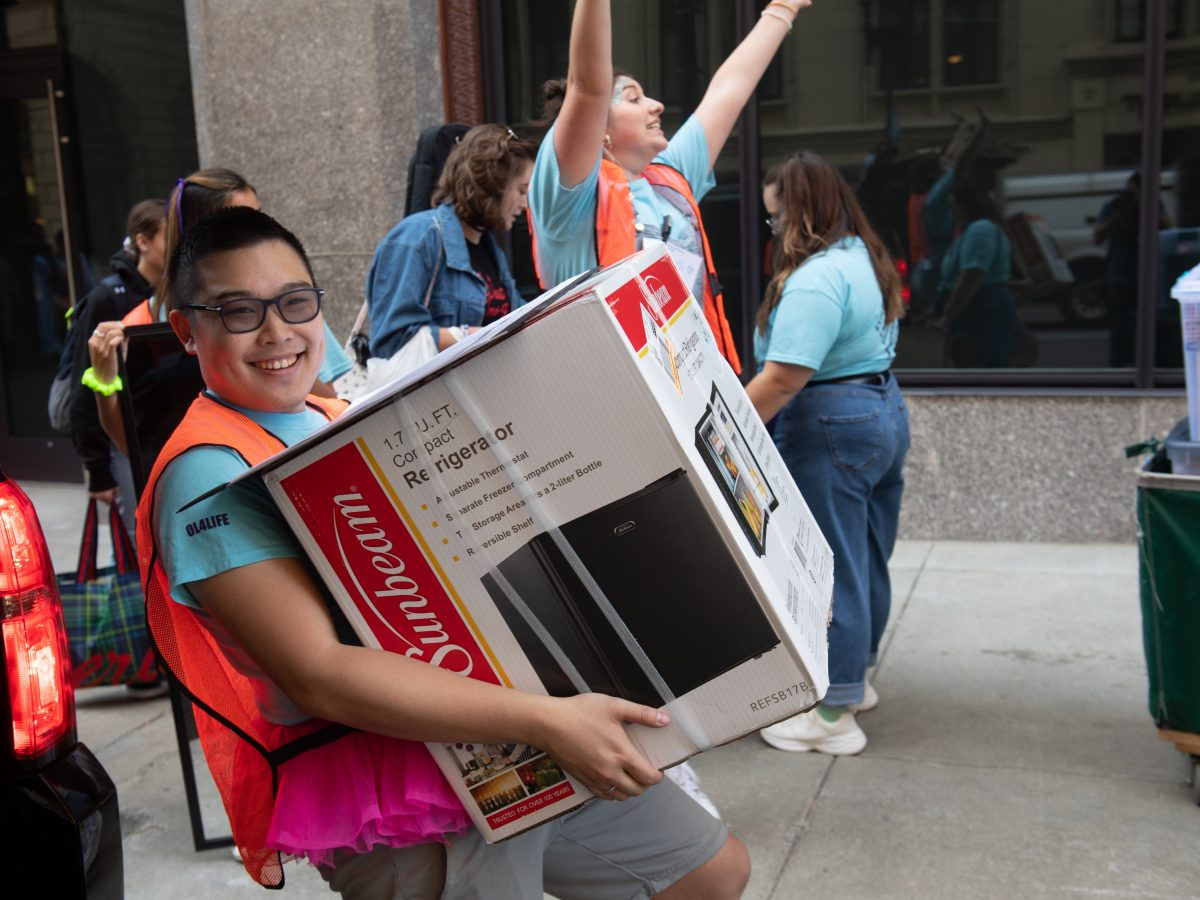 A student carries a box