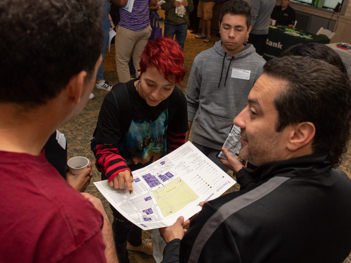 A student looks at a map of the campus